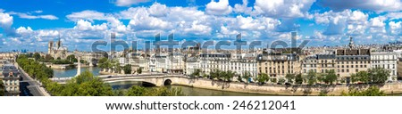Aerial panorama of Seine and Notre Dame de Paris in summer day - stock photo
