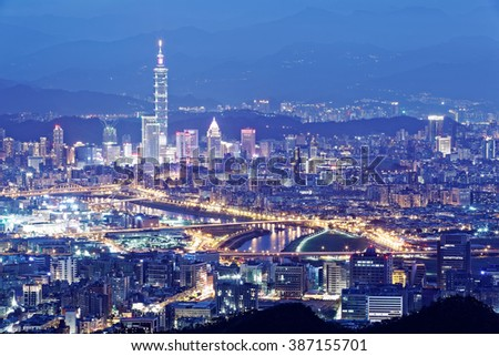 Aerial panorama of Taipei downtown & suburbs at dusk with view of Keelung Riverside Park, MacArthur bridge, Taipei 101 Tower in Xinyi District ~ A romantic evening in busy Taipei City in a  blue mood
