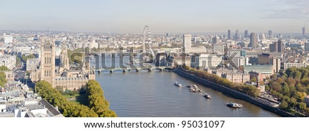 Aerial panorama view on London. View towards Houses of Parliament, London Eye and Westminster Bridge on Thames River. - stock photo