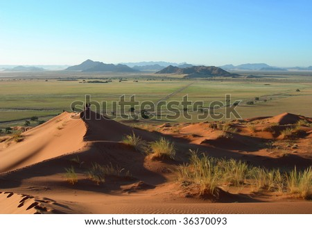 Aerial panoramic landscape with red sand dunes in the Kalahari Desert, Namibia, Africa - stock photo