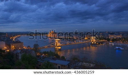 Aerial panoramic view of Budapest city from Castle Hill over Danube river, Chain Bridge and Parliament Building at twilight, Budapest, Hungary - stock photo