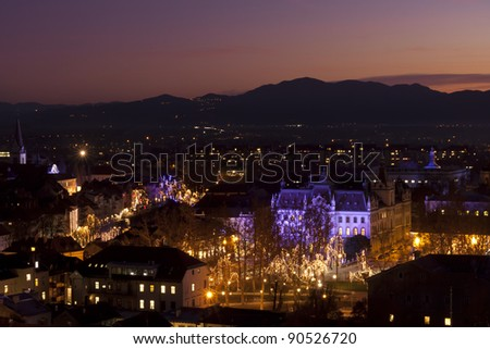 Aerial panoramic view of romantic medieval Ljubljana's city centre, the capital of Slovenia, decorated for Christmas holidays. Ljubljana, Slovenia, Europe.