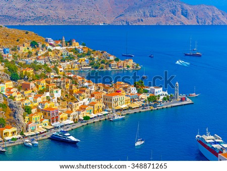 Aerial panoramic view of the pictorial old port of Symi island in Greece