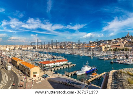 Aerial panoramic view on basilica of Notre Dame de la Garde and old port  in Marseille, France - stock photo