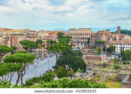 Aerial panoramic view on the Great Roman Colosseum (Coliseum, Colosseo, Flavian Amphitheatre.) and the Roman Forum in sunset time. Beautiful architectural and natural landscape. Rome. Italy. Europe. - stock photo