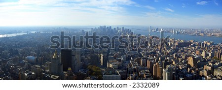 Aerial panoramic view over lower Manhattan from Empire State building top, New York - stock photo