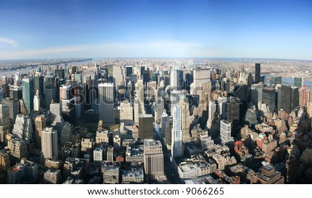 Aerial panoramic view over Manhattan from Empire State building top, New York. Sunny day, exceptional visibility, you could see far far away. - stock photo