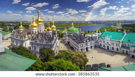 Aerial perspective of a panoramic view of the famous bell tower of the Kiev-Pechersk Lavra in the spring Kiev, temples Cathedral. Blooming chestnut foliage decorates the capital - stock photo