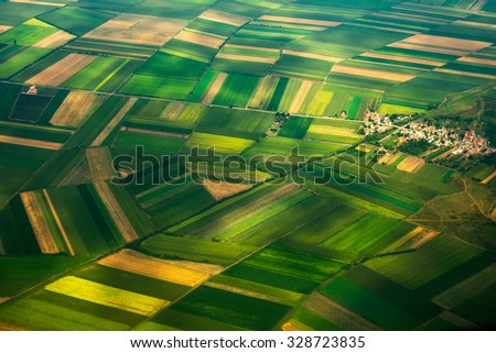 aerial photo from a plane, top view, field roads and city