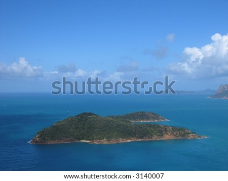 Aerial photo of a tropical island (Whitsunday islands, Queensland, Australia) - stock photo