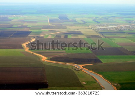 Aerial photo of Farmland and little river - stock photo