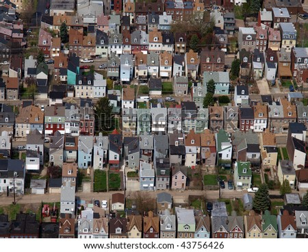Aerial photo of rust belt row homes in a large midwest US city, - stock photo