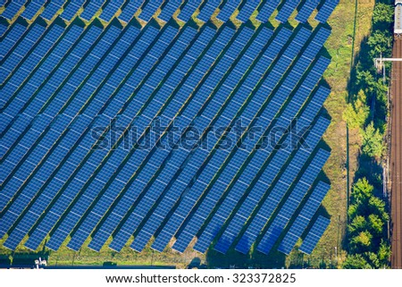 Aerial photo of solar power plant. Many solar energy panels in countryside from above. Brandenburg, Germany, EU - stock photo