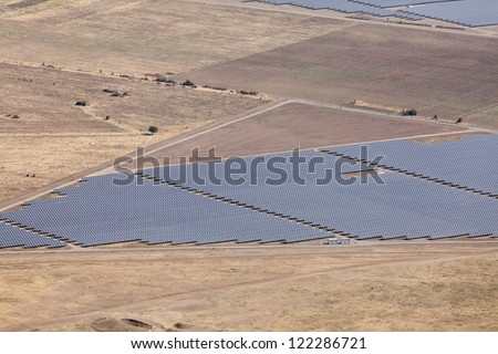 Aerial photo of solar power plant. Many solar energy panels in countryside from above. Photovoltaic power station near Kazanlak, Bulgaria, European union. - stock photo