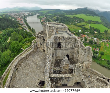 aerial photo of Strecno Castle near city Zilina, Slovakia. Vah river in background. - stock photo