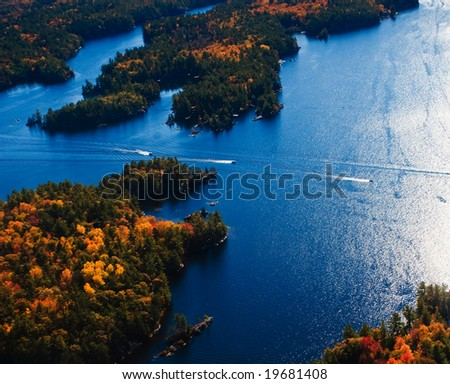 Aerial photograph of a lake during autumn - stock photo