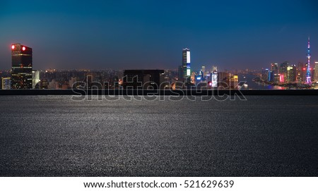 Aerial photography bird view at Empty road floor surface with city landmark buildings background at Shanghai bund panorama Skyline of night scene