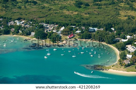 Aerial picture of the north coast of Mauritius Island. Small village of Cap Malheureux from above. Speed boat getting in the bay of Cap Malheureux