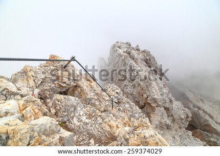 "Aerial ridge with protection cable along via ferrata ""Punta Ana"", Dolomite Alps, Italy - stock photo"