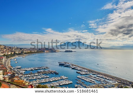 Aerial scenic view of Naples with Vesuvius volcano at sunrise. Campania, Southern Italy