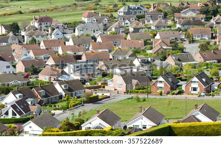 Aerial shot looking down on urban housing development - housing estate of mainly bungalows in Deganwy Wales - stock photo