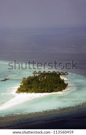 Aerial shot of a vacation island in the Maldives - stock photo