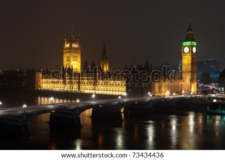 Aerial shot of Big Ben, the Halls of Parliament, and Westminster bridge in London in Horizontal at night
