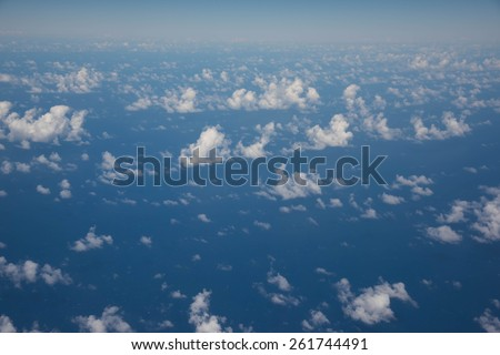Aerial shot of blue sky and clouds - stock photo