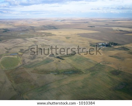 aerial shot of isolation between farms in Saskatchewan - stock photo