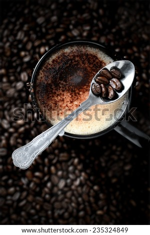 Aerial shot of mocha coffee and coffee beans with selective lighting. Copy space. - stock photo