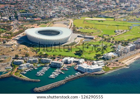 Aerial shot of public sport stadium near to Indian Ocean in Cape Town, South Africa - stock photo