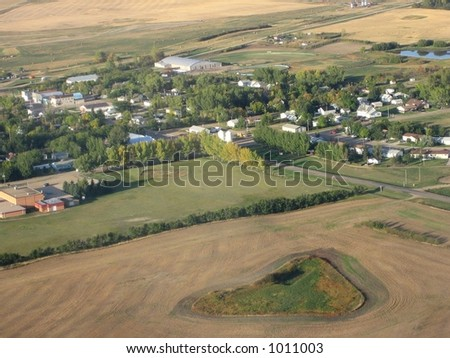aerial shot of saskatchewan city and farmland - stock photo