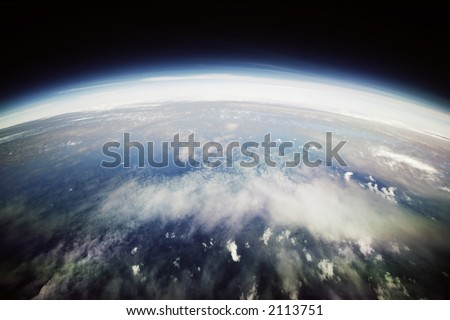 Aerial shot of scattered clouds in fisheye view