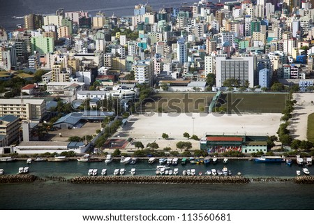Aerial shot of the Maldivian capital of Male from a plane - stock photo