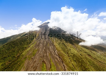 Aerial Shot Of Tungurahua Volcano Central Ecuador High Altitude From Full Size Helicopter - stock photo