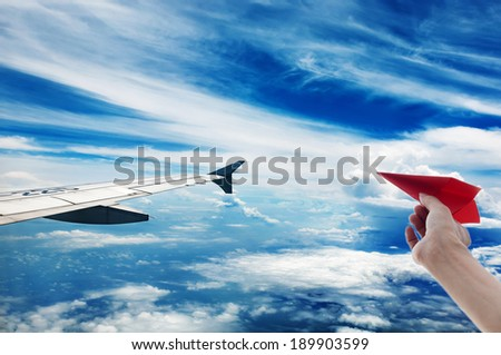 Aerial sky and clouds background, red paper-plane - stock photo