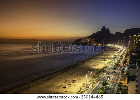 Aerial sunset view with light leaks on Ipanema Beach in Rio de Janeiro, Brazil - stock photo
