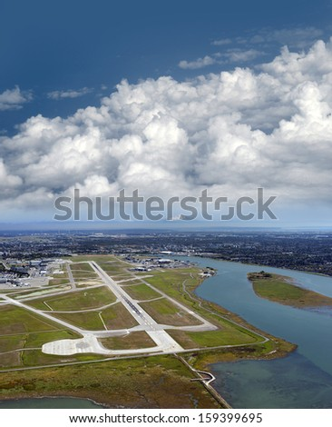 Aerial Vancouver - Airport on the Sea Island, Metro Vancouver and Mt. Baker - stock photo