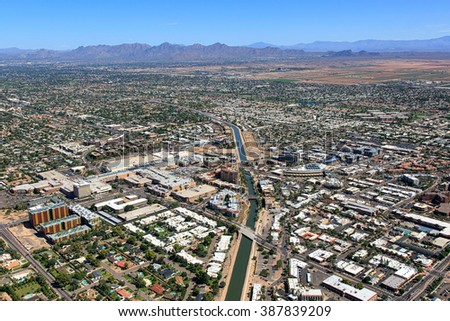 Aerial view above downtown Scottsdale, Arizona looking to the northeast with the McDowell Mountains in the distance - stock photo