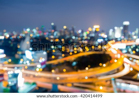 Aerial view, abstract blurred bokeh lights, Highway interchanged and city downtown background - stock photo