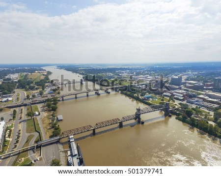 Aerial view Arkansas Inland Maritime Museum with Balao-class submarine along the north side of Arkansas river.  Available are Junction Bridge Pedestrian Walkway, I-30 and Arkansas River Trail Bridge.