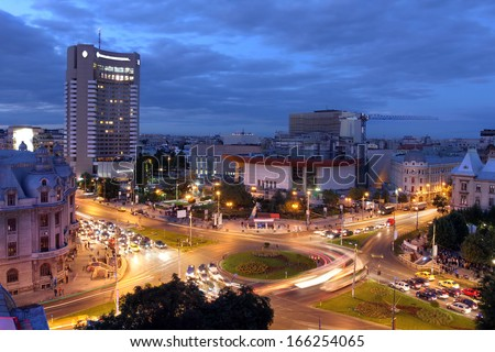 Aerial view at twilight of University Square (Piata Universitatii), Bucharest, Romania. This square is considered to be one of the focal points of the city.  - stock photo
