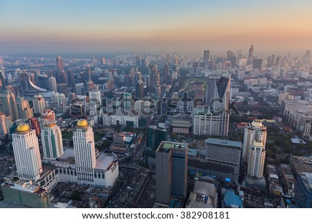 Aerial view Bangkok city downtown after sunset - stock photo