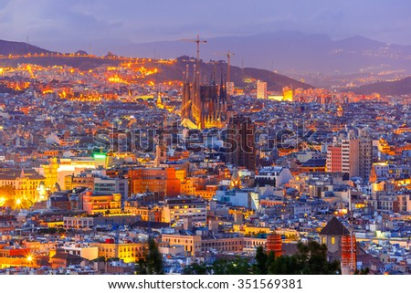 Aerial view Barcelona illuminated from the Montjuic hill at night, Catalonia, Spain. - stock photo