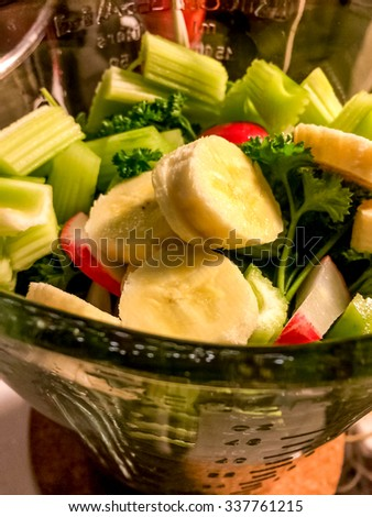 Aerial view blender with fresh fruits and vegetables for smoothie.  Homemade drink with fresh ingredients mixed in kitchen, perfect for food and healthy diet blog business website - stock photo