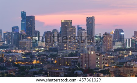 Aerial view city central business office building with dramatic sunset sky background