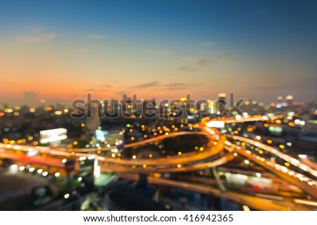 Aerial view city downtown background, abstract blurred bokeh lights night view - stock photo