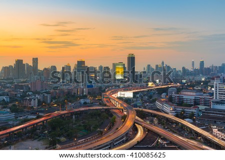 Aerial view city downtown background, highway interchanged, long exposure - stock photo