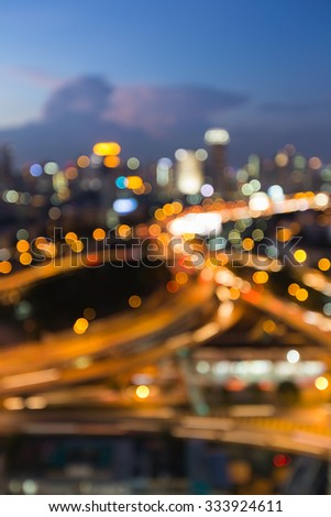 Aerial view city downtown road intersection during twilight, blurred bokeh light background - stock photo