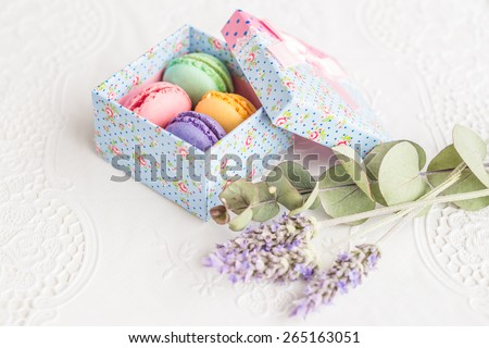 Aerial view colorful french macarons vintage style sweet dessert food  Delicious biscuit merinque from France in retro cupcake gift box for gastronomy bakery business website blog magazine book cover  - stock photo